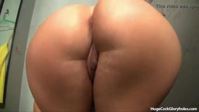 Hot blonde finds gloryhole in changing room